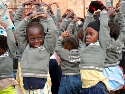 Children wear the sweaters knitted for them