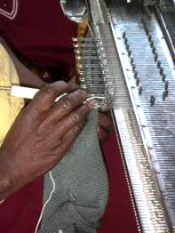 Close up of a knitting machine in use.